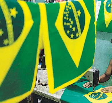 Tailors making flag of Brazil in Bangladesh